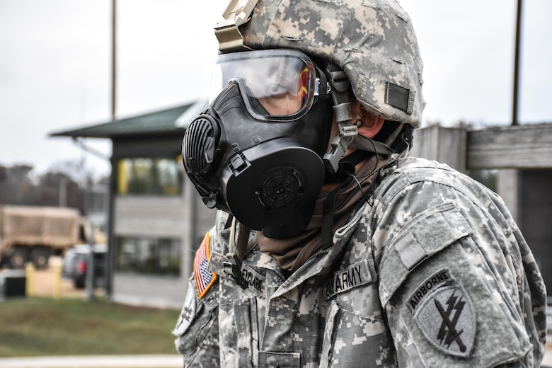 Sergeant Dyami Kellyclark, 443rd Civil Affairs Battalion, wears his gas mask on the M16 range at the 353rd Civil Affairs Command Best Warrior Competition at Fort McCoy, Wisconsin, November 2, 2017.  (U.S. Army Reserve photo by Catherine Lowrey, 88th Regional Support Command Public Affairs Office)