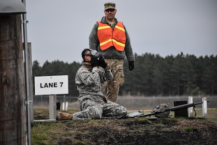 Sergeant Dyami Kellyclark, 443rd Civil Affairs Battalion, dons his gas mask on the M16 range at the 353rd Civil Affairs Command Best Warrior Competition at Fort McCoy, Wisconsin, November 2, 2017. 