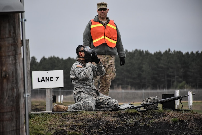 Sergeant Dyami Kellyclark, 443rd Civil Affairs Battalion, dons his gas mask on the M16 range at the 353rd Civil Affairs Command Best Warrior Competition at Fort McCoy, Wisconsin, November 2, 2017.  (U.S. Army Reserve photo by Catherine Lowrey, 88th Regional Support Command Public Affairs Office)