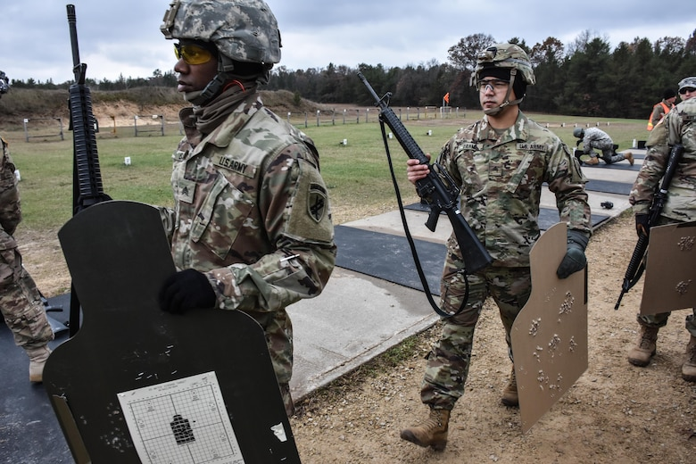 Soldiers competing in the 353rd Civil Affairs Command Best Warrior Competition collect their targets from the M16 rifle range at Fort McCoy, Wisconsin, November 2, 2017.
