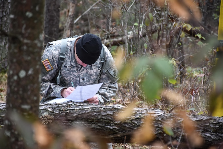 Sergeant Thomas Hardy, from 418th Civil Affairs Battalion, plots grid coordinates during the Land Navigation Course at the 353rd Civil Affairs Command Best Warrior Competition at Fort McCoy, Wisconsin, November 3, 2017. (U.S. Army Reserve photo by Catherine Lowrey, 88th Regional Support Command Public Affairs Office)
