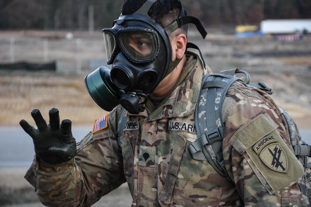 Specialist Pedro Benavides, from 407th Civil Affairs Battalion, wears his gas mask during the 353rd Civil Affairs Command Best Warrior Competition at Fort McCoy, Wisconsin, November 3, 2017. (U.S. Army Reserve photo by Catherine Lowrey, 88th Regional Support Command Public Affairs Office)