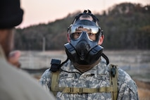 Sergeant Dyami Kellyclark, 443rd Civil Affairs Battalion, dons his gas mask during the Army Warrior Task lanes at the 353rd Civil Affairs Command Best Warrior Competition at Fort McCoy, Wisconsin, November 3, 2017.
