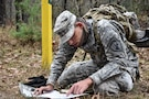 Sergeant Dyami Kellyclark, 443rd Civil Affairs Battalion, plots grid coordinates during the Land Navigation Course at the 353rd Civil Affairs Command Best Warrior Competition at Fort McCoy, Wisconsin, November 3, 2017. (U.S. Army Reserve photo by Catherine Lowrey, 88th Regional Support Command Public Affairs Office)