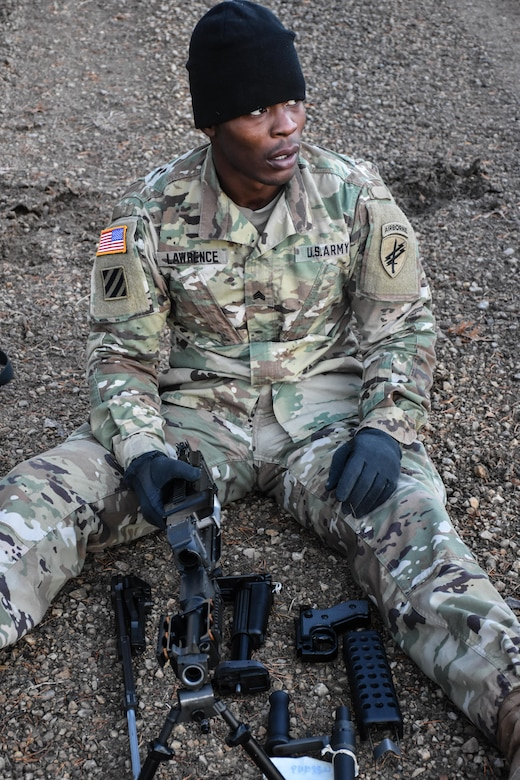 Sergeant Eric Lawrence, 411th Civil Affairs Battalion, disassembles a weapon during the Army Warrior Task lanes at the 353rd Civil Affairs Command Best Warrior Competition at Fort McCoy, Wisconsin, November 3, 2017.