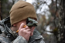 Specialist Christian Patton, 304th Civil Affairs Brigade, finds his next point on the Land Navigation Course during the 353rd Civil Affairs Command Best Warrior Competition at Fort McCoy, Wisconsin, November 3, 2017.