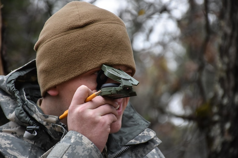 Specialist Christian Patton, 304th Civil Affairs Brigade, finds his next point on the Land Navigation Course during the 353rd Civil Affairs Command Best Warrior Competition at Fort McCoy, Wisconsin, November 3, 2017. (U.S. Army Reserve photo by Catherine Lowrey, 88th Regional Support Command Public Affairs Office)