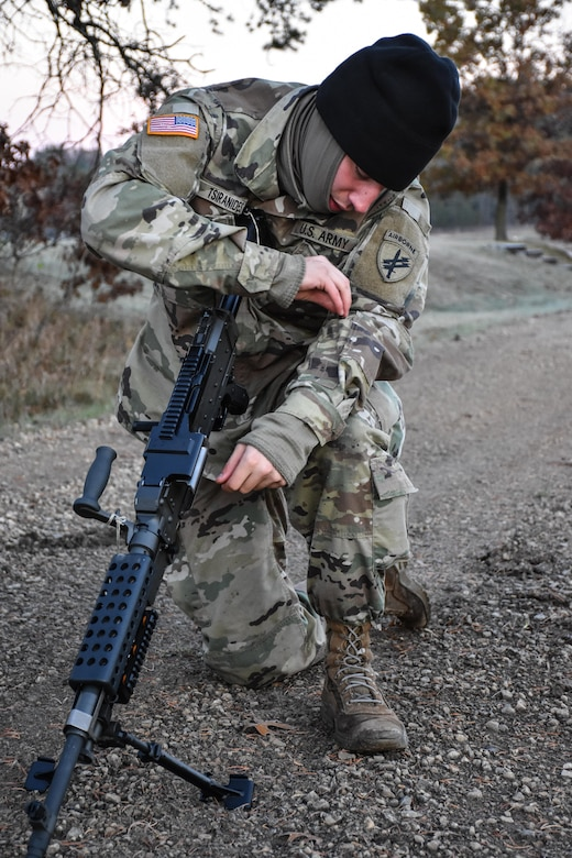 Private Second Class Yanni Tsiranides, 411th Civil Affairs Battalion, performs a functions check on a weapon during the Army Warrior Task lanes at the 353rd Civil Affairs Command Best Warrior Competition at Fort McCoy, Wisconsin, November 3, 2017. Tsiranides went on to win the title of 353rd CACOM 2017 Soldier of the Year.  (U.S. Army Reserve photo by Catherine Lowrey, 88th Regional Support Command Public Affairs Office)