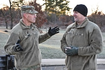 U.S. Army Civil Affairs & Psychological Operations Command (Airborne) Command Sgt. Maj. Pete Running, left, talks about Soldier readiness with 353rd Civil Affairs Command Sgt. Maj. Stephen Coville, right, during the 353rd Civil Affairs Command Best Warrior Competition at Fort McCoy, Wisconsin, November 3, 2017.