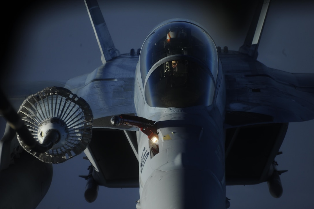 An EA-18G Growler pilot prepares to receive fuel by a KC-10 Extender over Syria, Oct. 27, 2017. The Growler's vast array of sensors and weapons provides the warfighter with a lethal and survivable weapon system to counter current and emerging threats. (U.S. Air Force photo by Tech. Sgt. Anthony Nelson Jr.)