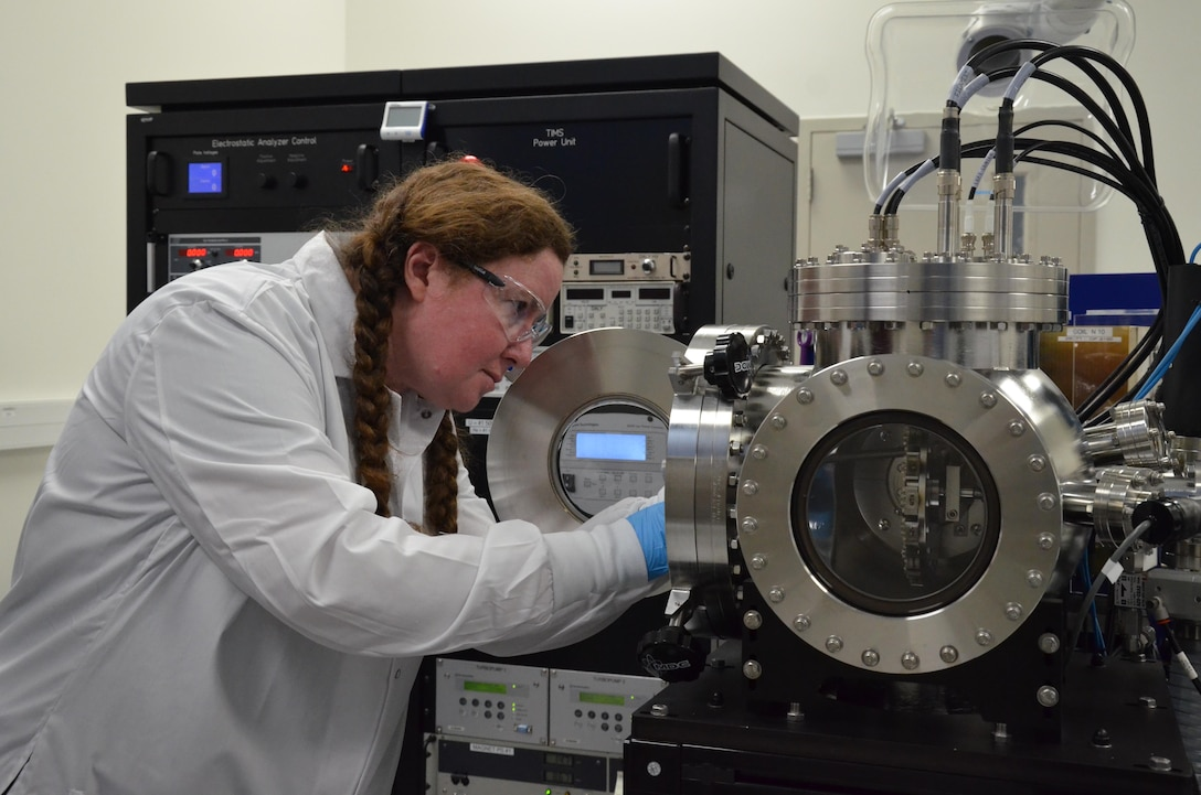 Claudia Granger, a mass spectrometry operator at the Ciambrone Radiochemistry Lab at Patrick AFB, Fla., loads a filament wheel into a thermal ionization spectrometer, which is used to analyze trace amounts of uranium or plutonium extracted from environmental samples.  Granger is one of 60 CRL scientists headquartered at the Air Force Technical Applications Center who executes the Nuclear Debris Collection and Analysis program.  (U.S. Air Force photo by Susan A. Romano)