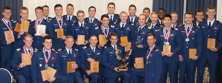USAFA Flying Team National Intercollegiate Flying Association competition champions pose with their awards during the award ceremony. (U.S. Air Force photo by Tsali Bentley)