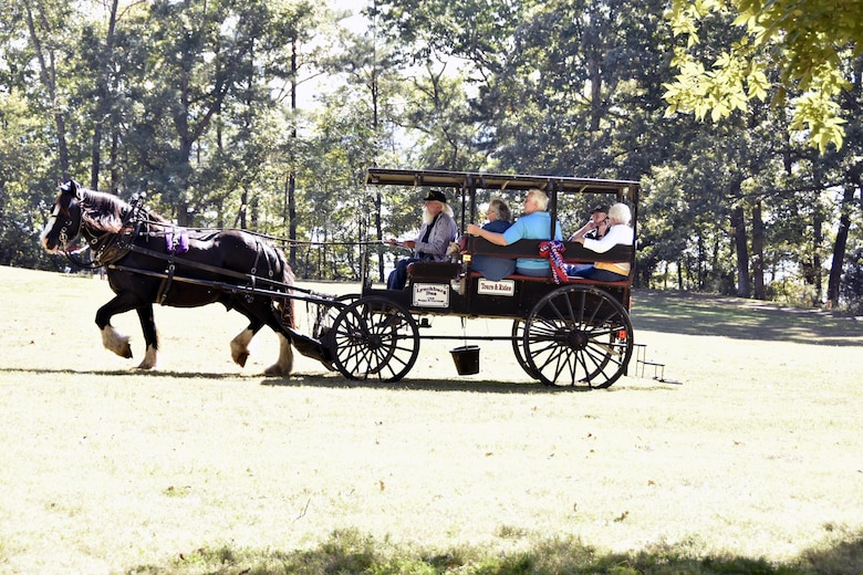Guests of the Military Appreciation: Past, Present and Future picnic take part in a buggy ride. The Oct. 20 picnic at Arnold Lakeside Center was open to retired military, veterans and active-duty services members and their families. (U.S. Air Force photo/Rick Goodfriend)