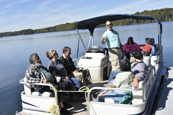 Attendees of the Military Appreciation: Past, Present and Future Picnic prepare for a boat ride on Woods Reservoir. The picnic, held Oct. 20 at the Arnold Lakeside Center, was open to retired military, veterans and active-duty services members and their families. (U.S. Air Force photo/Rick Goodfriend)
