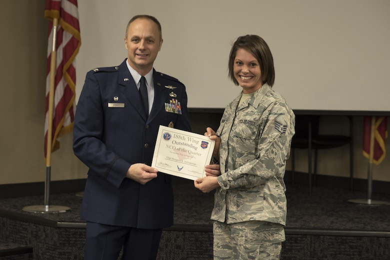 Staff Sgt. Morgana Schluterman, accepts the Noncommissioned officer of the Quarter award from Col. Robert Kinney, 188th Wing commander, Nov. 4, 2017, at Ebbing Air National Guard Base, Fort Smith, Ark. The award is given to airmen that have provided exceptional service to the wing throughout the last quarter and distinguished themselves among the best in the 188th. Winners were selected in the Airman, NCO, Senior NCO, First Sergeant, CGO and Field Grade Officer categories. (U.S. Air National Guard photo by Tech. Sgt. Daniel Condit)