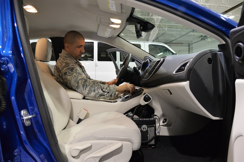 Airman 1st Class Mark Martinez, 341st Logistics Readiness Squadron vehicle operator, checks the condition of a vehicle Nov. 7, 2017, at Malmstrom Air Force Base, Mont.