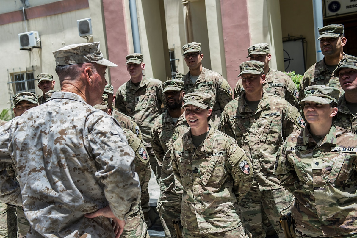 Marine Corps Gen. Joe Dunford, chairman of the Joint Chiefs of Staff, speaks with soldiers in Afghanistan.