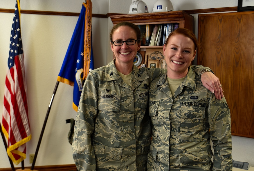 Commander poses with Airman