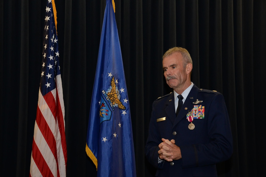 Lt. Col.  Luke Thompson, the  302nd Airlift Wing chief of aerial firefighting and command pilot, speaks to the audience during his retirement ceremony at Peterson Air Force Base, Colo. Nov. 5, 2017.
