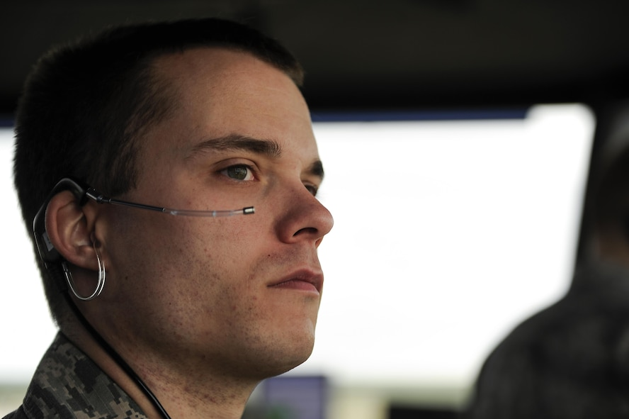 Staff Sgt. Dylan Edney, 47th Operations Support Squadron air traffic control watch supervisor, monitors flightline activity during a morning shift at Laughlin Air Force Base, Texas, Oct. 24, 2017. Laughlin's air traffic control tower is manned by five positions--the watch supervisor, the supervisor of flying, flight data, ground control and local control. (U.S. Air Force/Airman 1st Class Benjamin N. Valmoja)