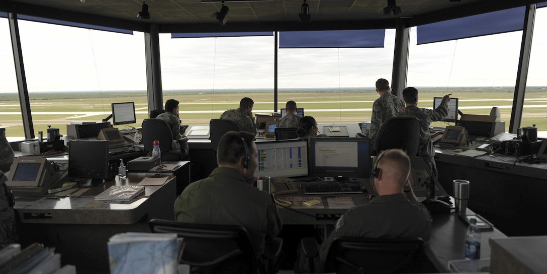 Airmen of the 47th Operations Support Squadron air traffic control tower perform their daily operations at Laughlin Air Force Base, Texas, Oct. 24, 2017. Laughlin's tower is capable of operating with just four air traffic controllers, but with a busy training schedule, controllers in training must shadow certified controllers, which sometimes brings that number to eight. (U.S. Air Force/Airman 1st Class Benjamin N. Valmoja)