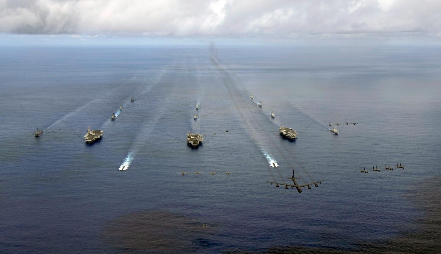 File photo: USS KITTY HAWK, at sea (Aug.14, 2007) - USS Nimitz (CVN 68), USS Kitty Hawk (CV 63), and USS John C. Stennis (CVN 74) carrier strike groups steam in formation during a joint photo exercise (PHOTOEX) during exercise Valiant Shield 2007 Aug.14.
