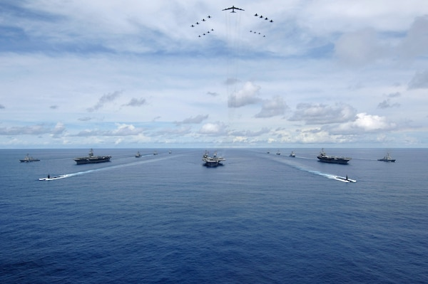 USS KITTY HAWK at sea- USS Nimitz, USS Kitty Hawk, and USS John C. Stennis carrier strike groups steam in formation during a joint