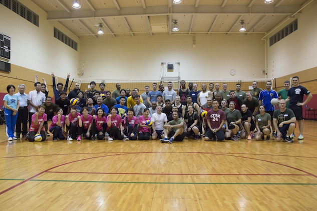 CAMP FOSTER, OKINAWA, Japan – Participants in the Friendship Volleyball Event pose for a group photo Nov. 7 aboard Camp Foster, Okinawa, Japan.