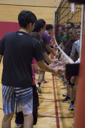 CAMP FOSTER, OKINAWA, Japan – Two teams shake hands after a game Nov. 7 at the Friendship Volleyball Event aboard Camp Foster, Okinawa, Japan.