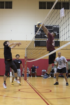 CAMP FOSTER, OKINAWA, Japan – A Marine blocks the ball during a game at the Friendship Volleyball Event Nov. 7 aboard Camp Foster, Okinawa, Japan.