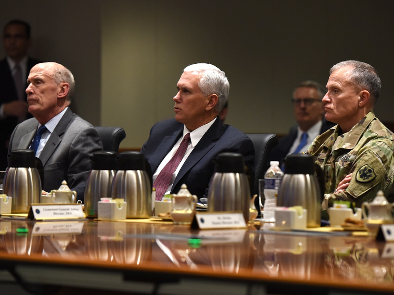 From left, Director of National Intelligence Dan Coats, Vice President Mike Pence and Defense Intelligence Agency Director Lt. Gen. Robert Ashley listen to an intelligence brief during the vice president's visit to DIA headquarters Nov. 6, at Joint Base Anacostia-Bolling in Washington, D.C.