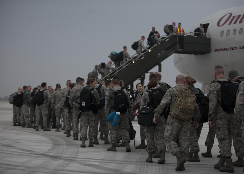 U.S. Air Force Airmen assigned to the Wisconsin Air National Guard 115th Fighter Wing, board their flight home as they prepare to depart the installation at Kunsan Air Base, Republic of Korea, Nov. 8, 2017.  The 115th FW participated in a three-month Theater Security Package rotational Deployment to Kunsan AB as part of maintaining peace and security in the Indo-Asia-Pacific region. (U.S. Air Force photo by Staff Sgt. Victoria H. Taylor)