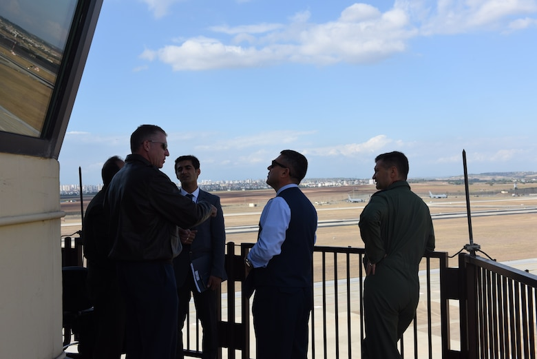 Col. David Eaglin, 39th Air Base Wing commander, talks with Brig. Gen. Necati Gunduz and Brig. Gen. Ismail Gunaydin at the tower during the Defense and Economic Cooperation Agreement inspection at Incirlik Air Base, Turkey, Oct. 30, 2017.