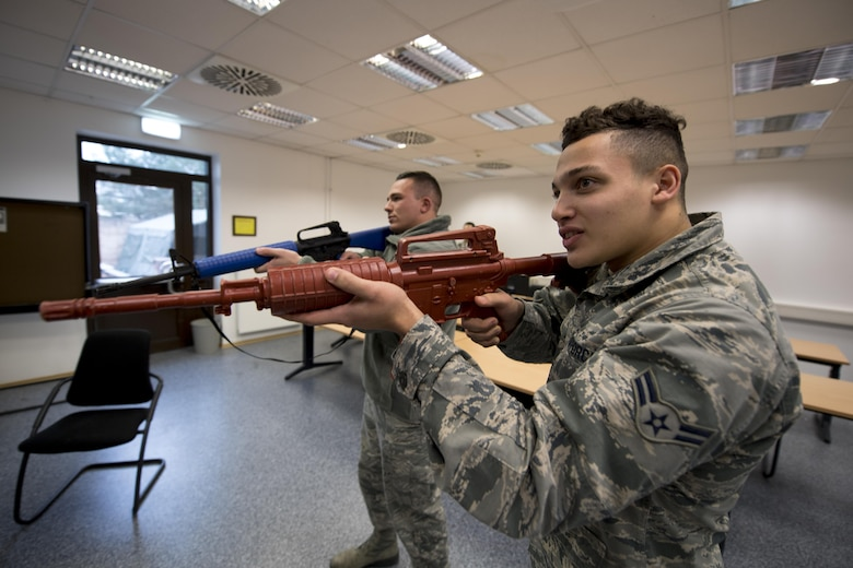 U.S. Air Force Airman 1st Class Tariq Hilaire, right, and Airman 1st Class Taylor Dawson, 86th Security Forces Squadron's Selectively Trained And Ready augmentees, run a de-escalation simulation at the 86th SFS training facility on Ramstein Air Base, Germany, Nov. 7, 2017. STAR is a program that instills general security forces and force protection knowledge to qualified 86th Airlift Wing and tenant unit active duty Airmen rank E-5 and below to assist security forces in protecting the installation, personnel and resources. (U.S. Air Force photo by Senior Airman Devin Boyer)