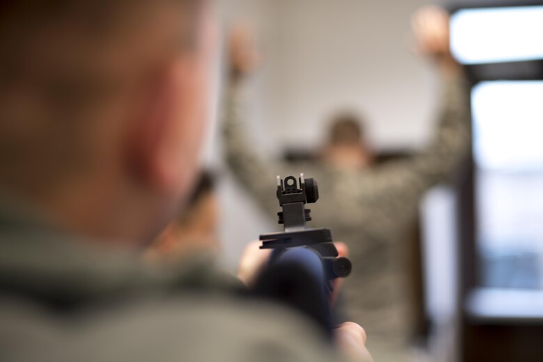 A U.S. Air Force Airman detains an Airman with a training rifle during a Selectively Trained And Ready simulation at the 86th Security Forces Squadron training facility on Ramstein Air Base, Germany, Nov. 7, 2017. The simulation instructs STAR augmentees when to use lethal force and when not to. (U.S. Air Force photo by Senior Airman Devin Boyer)