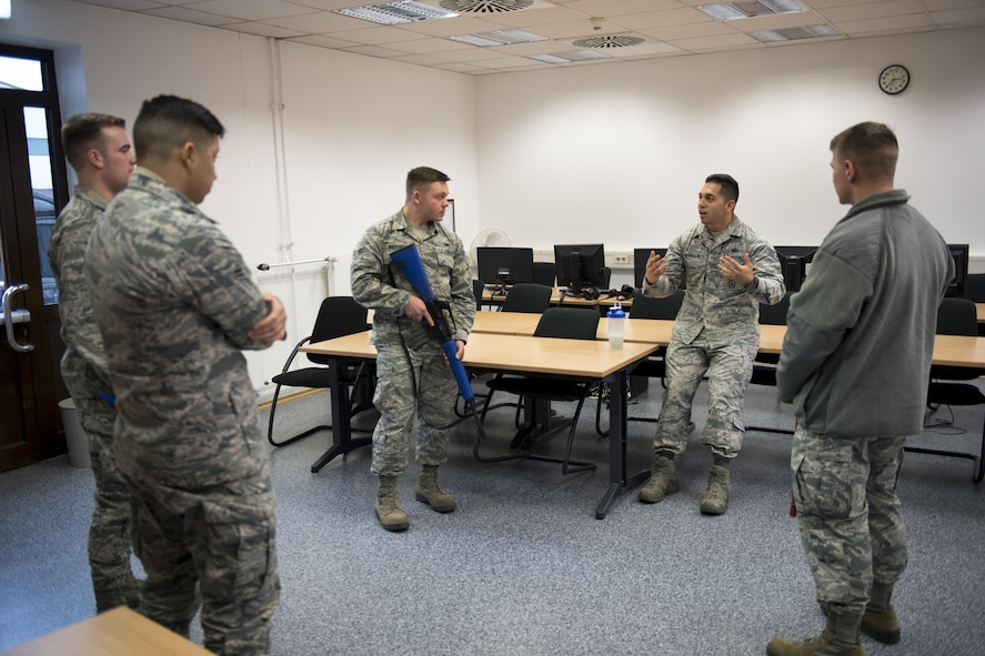U.S. Air Force Staff Sgt. Salvador Alvarado, 86th Security Forces Squadron trainer, debriefs Selectively Trained And Ready augmentees after running a simulation at the 86th SFS training facility on Ramstein Air Base, Germany, Nov. 7, 2017. The STAR program provides Kaiserslautern Military Community installations a pool of personnel to ease units' burden of long-term commitment by supplementing security forces. (U.S. Air Force photo by Senior Airman Devin Boyer)