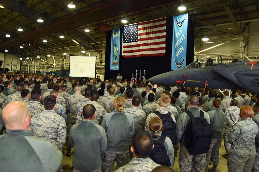 A crowd of Airmen from the 48th Fighter Wing listen to Lt. Gen. Richard M. Clark, 3rd Air Force Commander, speak during his presentation at Royal Air Force Lakenheath, England, Nov. 7. The general handed out various awards to outstanding Airmen for their contributions towards the mission. (U.S. Air Force photo/Airman 1st Class Christopher S. Sparks)