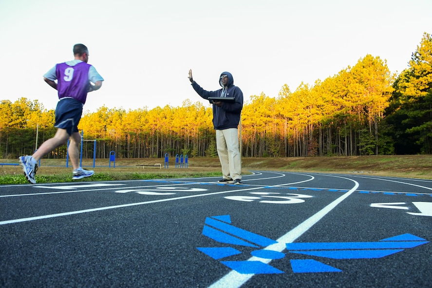 Kenneth Duhart, 94th Airlift Wing exercise physiologist, right, tells a runner his time during a physical fitness test at the Dobbins Air Reserve Base track Oct. 30, 2017. The track was closed for about a month as crews worked to have it repaved and restriped. (U.S. Air Force photo/Staff Sgt. Andrew Park)