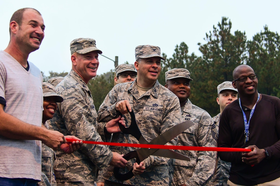 Col. Marty Hughes, 94th Mission Support Group commander, prepares to cut a ribbon during a reopening ceremony at the base track at Dobbins Air Reserve Base, Ga. Nov. 5, 2017. The renovation process lasted about a month as crews worked quickly to have it repaved and restriped. (U.S. Air Force photo/Staff Sgt. Andrew Park)