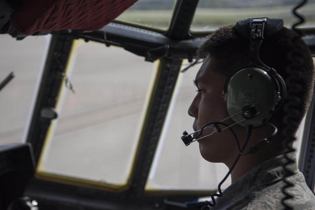 U.S. Air Force Senior Airman Steven Tovar, 86th Aircraft Maintenance Squadron C-130J Super Hercules crew chief, sits in the pilot seat of a C-130J while taxiing to a parking spot on Ramstein Air Base, Germany, Oct. 13, 2017. Crew chiefs ensure all issues are resolved with the aircraft, so the aircrew will be able to accomplish their mission. (U.S. Air Force photo by Airman 1st Class Devin M. Rumbaugh)