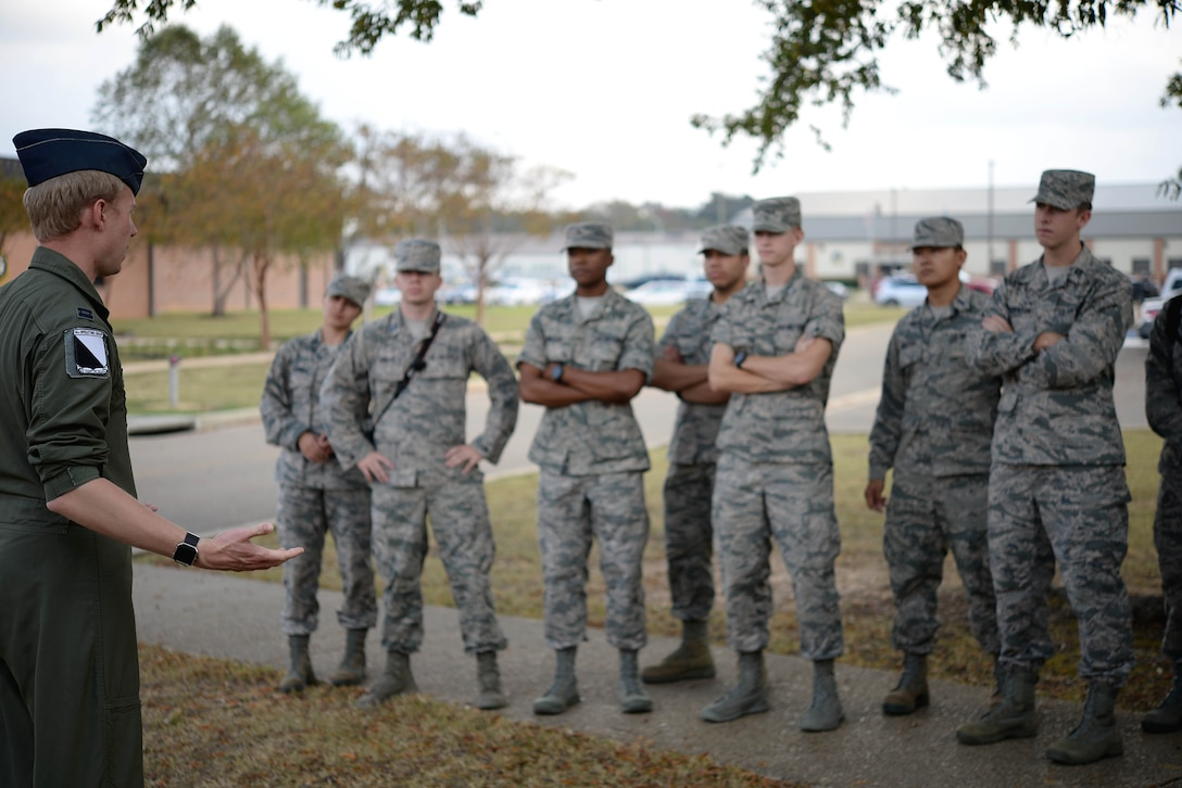 Capt. Christian Litscher, 14th Operations Group Commander's Action Group officer, speaks to cadets about what pilot training is like on Columbus Air Force Base, Mississippi, Nov. 3, 2017. The students were split into groups; some of them got a close-up look at Columbus AFB's three aircraft while others received tours of the flying training squadrons as they spoke with experienced Air Force pilots. (U.S. Air Force photo by Airman 1st Class Keith Holcomb)