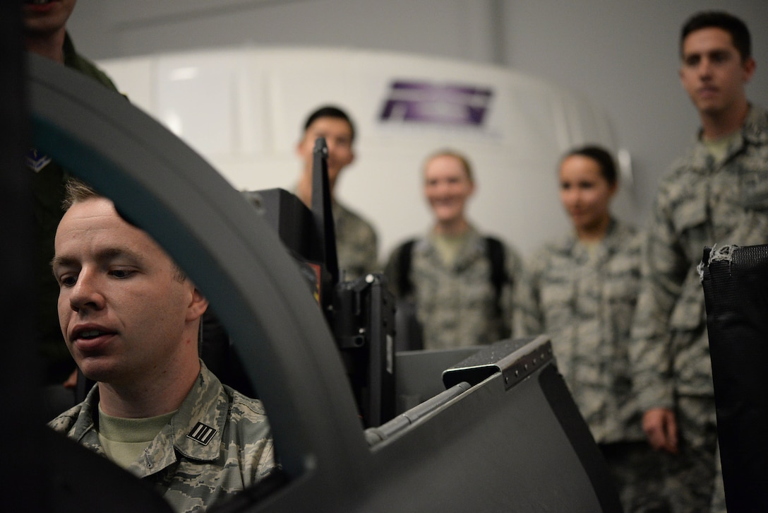 Cadets take turns flying in T-38 Talon simulators during a base tour Nov. 3, 2017, on Columbus Air Force Base, Mississippi. At the end of the tour the seniors of the class were given pieces of paper with facts about another cadet in the detachment. The seniors had to find the correlating cadet who then gave the seniors the Air Force Specialty Code they each will prepare to move to. (U.S. Air Force photo by Airman 1st Class Keith Holcomb)