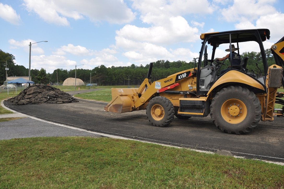 A contractor uses a front end loader to remove the surface of the track at Dobbins Air Reserve Base, Ga. Sept. 27, 2017. The renovation process lasted about a month as crews worked quickly to have it repaved and restriped. (U.S. Air Force photo/Master Sgt. James Branch)