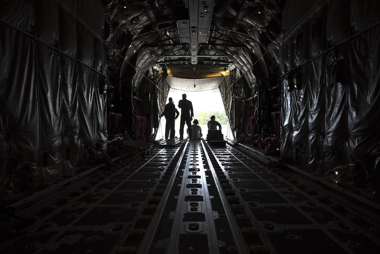 U.S. Airmen assigned to the 86th Aircraft Maintenance Squadron and 37th Airlift Squadron sit in a C-130J Super Hercules during taxi to a parking spot on Ramstein Air Base, Germany, Oct. 13, 2017. Crew chiefs work hand in hand with pilots to ensure all the issues that arise with the aircraft are resolved. (U.S. Air Force photo by Airman 1st Class Devin M. Rumbaugh)