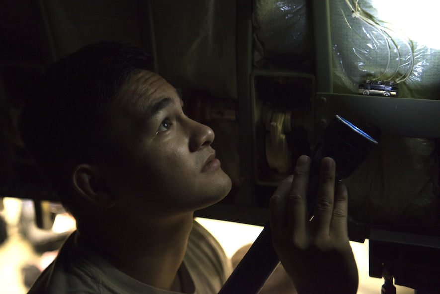U.S. Air Force Senior Airman Joshua Dayrit, 86th Aircraft Maintenance Squadron C-130J Super Hercules crew chief, shines a flashlight at a broken aircraft part on Ramstein Air Base, Germany, Oct. 13, 2017. Crew chiefs are responsible for general maintenance and repairs on aircraft. (U.S. Air Force photo by Airman 1st Class Devin M. Rumbaugh)