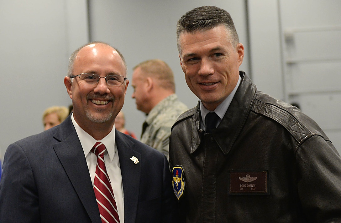 Dr. Thomas Huebner, President of East Mississippi Community College, and Col. Douglas Gosney, 14th Flying Training Wing Commander, talk during the Proud to be an American event Nov. 7, 2017, on the EMCC campus in Mayhew, Mississippi. Gosney spoke about the reasons he is proud to be an American and explained the many types of heroes America has outside of the Department of Defense. (U.S. Air Force photo by Airman 1st Class Keith Holcomb)