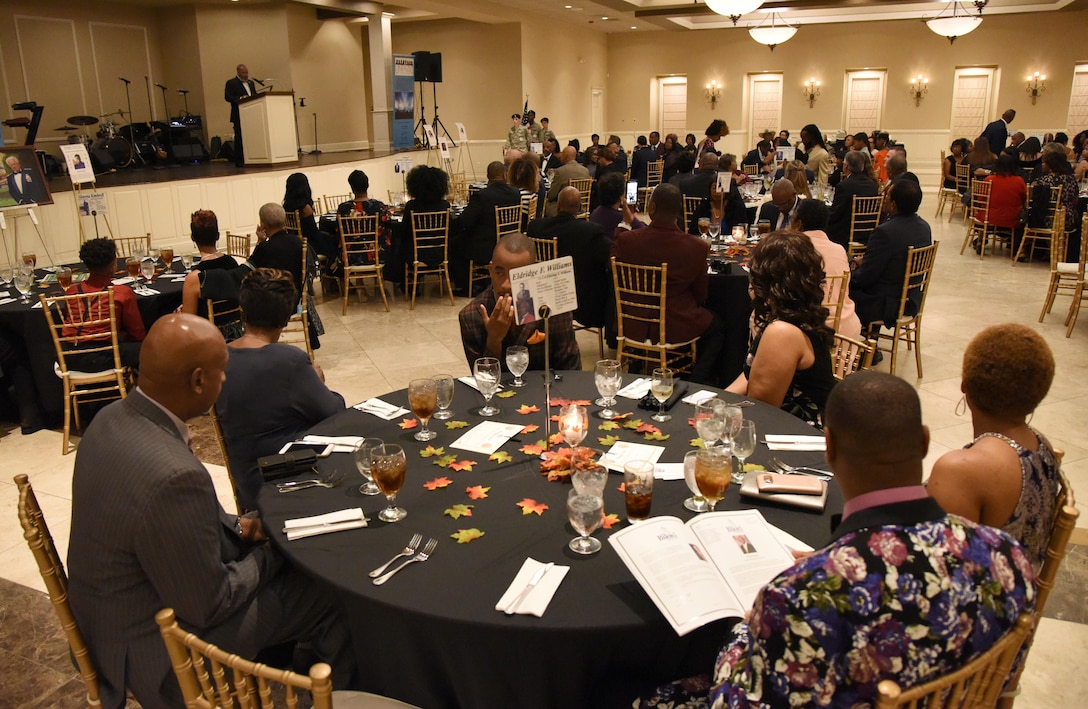 "Keesler personnel and community members attend the Tuskegee Airmen Inc. 8th Annual Benefit Gala at the Slavonian Lodge Nov. 4, 2017, in Biloxi, Mississippi. The event, which was held to raise funds for the Col. Lawrence E. Roberts Scholarships Fund, also included a silent auction and dinner. The gala's theme was ""We weren't assigned, we were requested."" (U.S. Air Force photo by Kemberly Groue)"