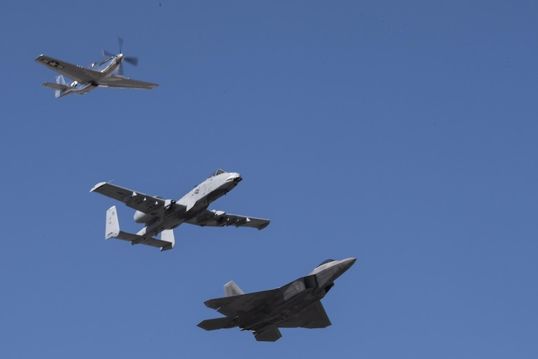 A P-51 Mustang, an A-10C Thunderbolt II and a F-22 Raptor perform a heritage flight during the Naval Air Station Jacksonville Air Show, Nov. 3, 2017, at NAS Jacksonville, Nov. 3, 2017, at NAS Jacksonville, Fla. The U.S. Air Force Heritage Flight program showcases past, present and future aircraft to spectators at air shows around the world. (U.S. Air Force photo by Staff Sgt. Eric Summers Jr.)