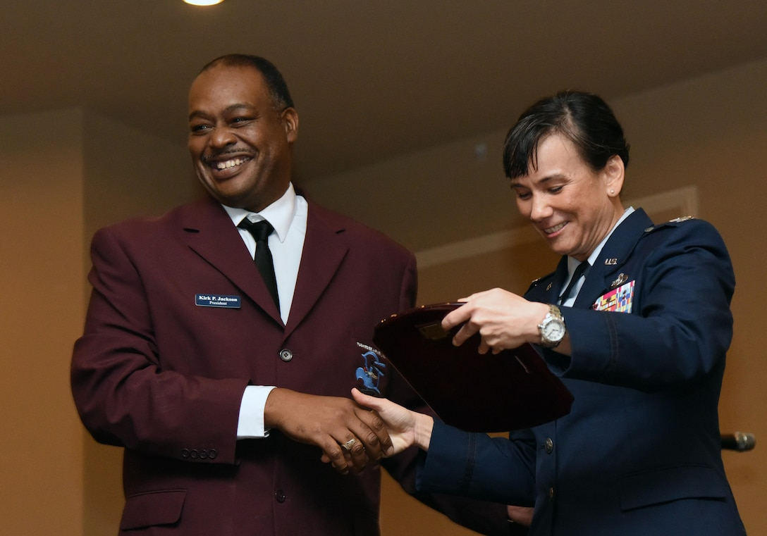 "Retired Tech. Sgt. Kirk Jackson, Col. Lawrence E. Roberts Chapter of Tuskegee Airmen Inc. president, presents a memento to Col. Debra Lovette, 81st Training Wing commander, during the Tuskegee Airmen Inc. 8th Annual Benefit Gala at the Slavonian Lodge Nov. 4, 2017, in Biloxi, Mississippi. Lovette was the guest speaker for the event, which was held to raise funds for the Col. Lawrence E. Roberts Scholarships Fund. The gala's theme was ""We weren't assigned, we were requested."" (U.S. Air Force photo by Kemberly Groue)"