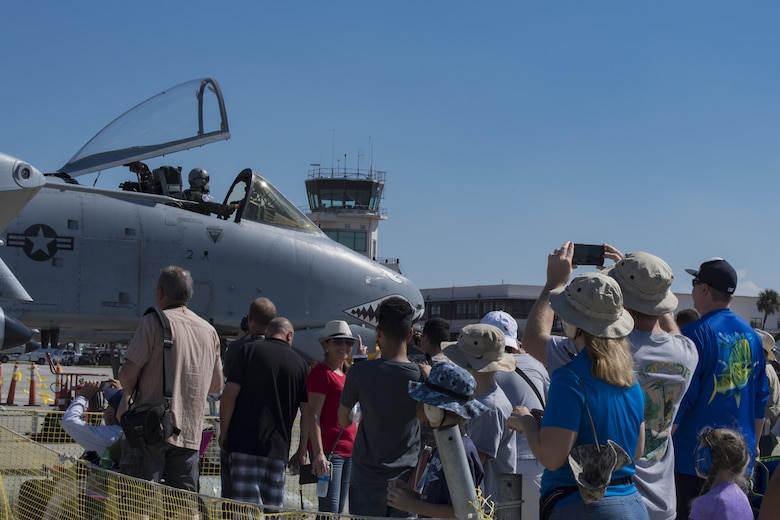 A crowd at the Naval Air Station Jacksonville Air Show watches and applauds as an A-10C Thunderbolt II parks after performing in a heritage flight, Nov. 4, 2017, at NAS Jacksonville, Fla. The U.S. Air Force Heritage Flight program showcases past, present and future aircraft to spectators at air shows around the world. (U.S. Air Force photo by Staff Sgt. Eric Summers Jr.)